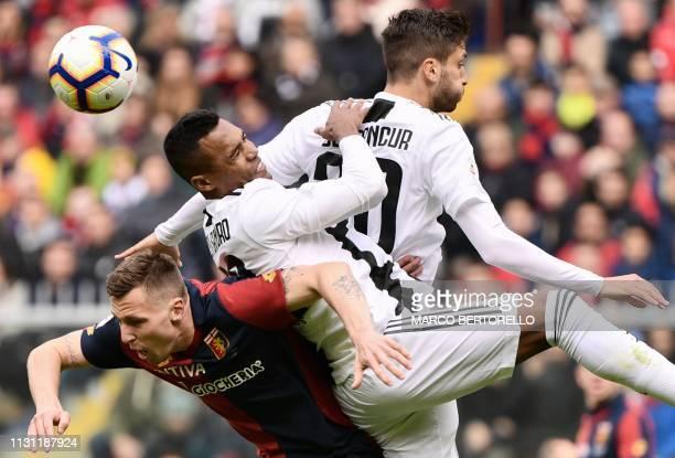 Genoa's Danish midfielder Lukas Lerager, Juventus' Brazilian defender Alex Sandro and Juventus' Uruguayan midfielder Rodrigo Bentancur go for a...