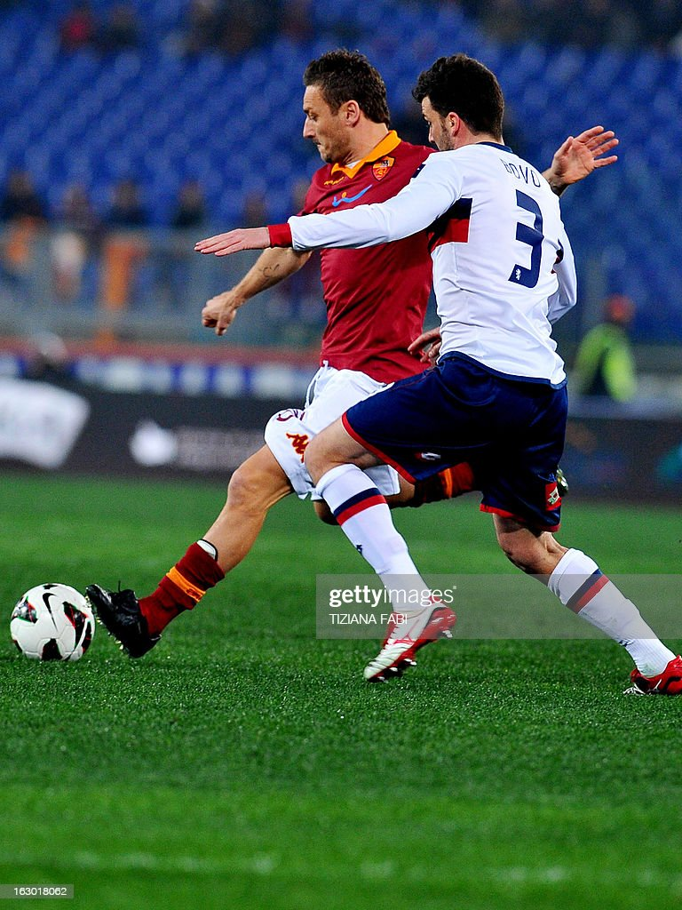 Genoa's defender Cesare Bovo (R) vies for the ball with AS Roma's forward Francesco Totti (L) during the Italian Serie A football match AS Romsa vs Genoa at Olympic Stadium on March 3, 2013 in Rome.