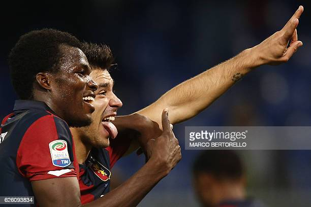 Genoa's forward Giovanni Simeone and Genoa's Ghanaian midfielder Isaac Cofie celebrate at the end of the Italian Serie A football match Genoa Vs...