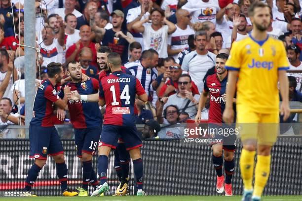 Genoa's forward Goran Pandev celebrates with his teammates after scoring during the Italian Serie A football match Genoa v Juventus at The Luigi...