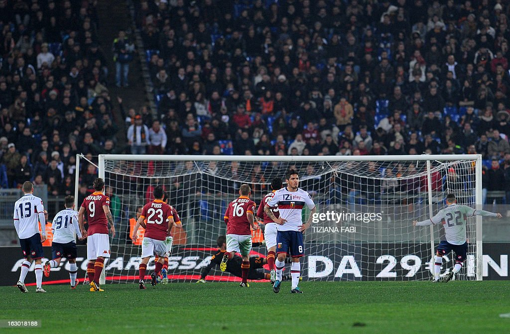 Genoa's forward Marco Borriello (R) scores a penalty against Roma during the Italian Serie A football match AS Roma vs Genoa at Olympic Stadium in Rome on March 3, 2013.