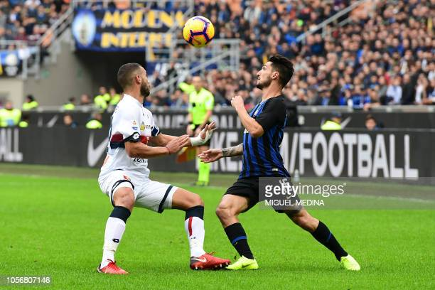 Genoa's Italian defender Davide Biraschi fights for the ball with Inter Milan's Italian midfielder Matteo Politano during the Italian Serie A...