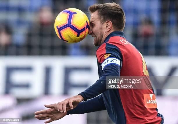 Genoa's Italian defender Domenico Criscito head controls the ball during the Italian Serie A football match Genoa vs AC Milan on January 21 2019 at...