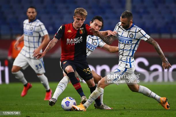 Genoa's Italian defender Nicolo Rovella from fights for the ball with Inter Milan's Croatian midfielder Marcelo Brozovic during the Italian Serie A...