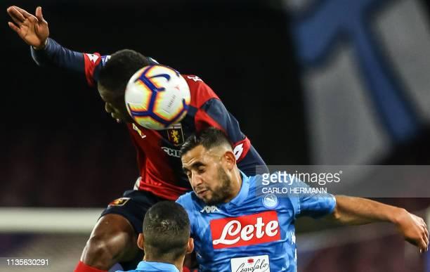 Genoa's Italian forward Cristian Kouame and Napoli's Algerian defender Faouzi Ghoulam go for a header during the Italian Serie A football match...