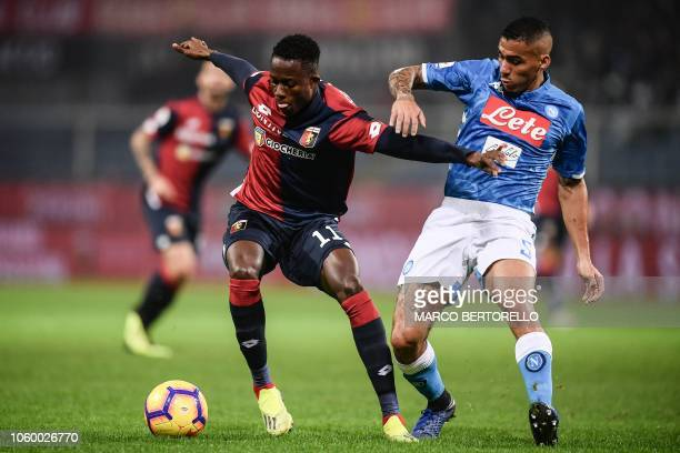 Genoa's Italian forward Cristian Kouame and Napoli's Brazilian midfielder Allan go for the ball during the Italian Serie A football match Genoa vs...