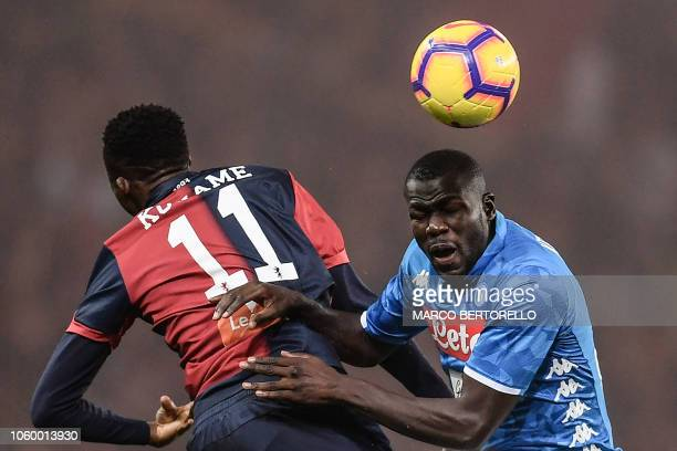 Genoa's Italian forward Cristian Kouame and Napoli's Senegalese defender Kalidou Koulibaly go for a header during the Italian Serie A football match...