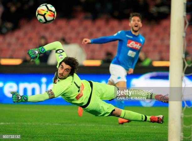 TOPSHOT Genoa's Italian goalkeeper Mattia Perin dives after Napoli's Belgian striker Dries Mertens' shot the ball during the Italian Serie A football...