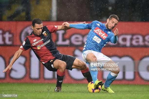 Genoa's Italian midfielder Romulo and Napoli's Belgian forward Dries Mertens go for the ball during the Italian Serie A football match Genoa vs...