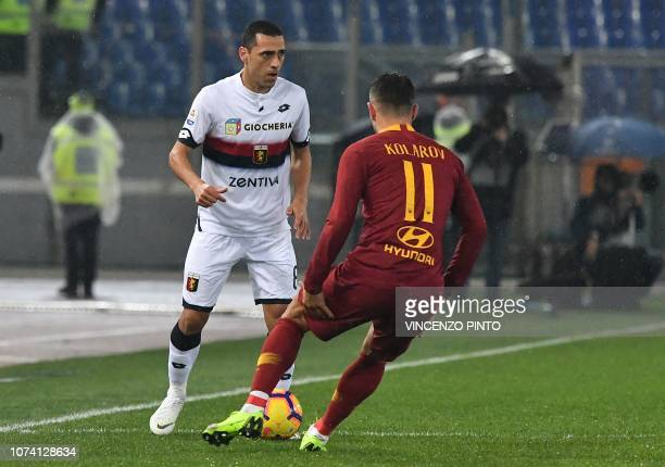 Genoa's Italian midfielder Romulo challenges AS Roma Serbian defender Aleksandar Kolarov during the Italian Serie A football match AS Roma vs Genoa...