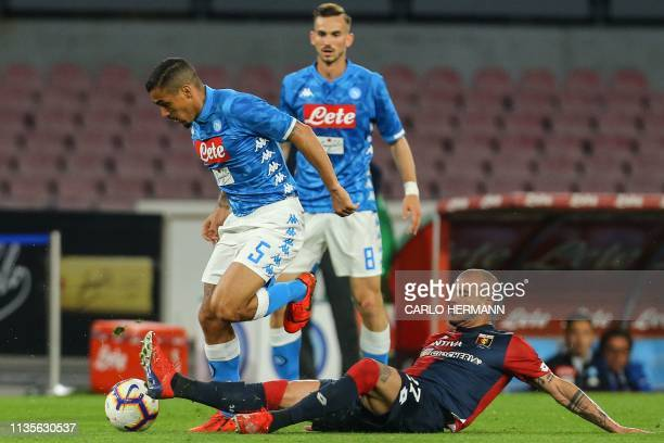 Genoa's Italian midfielder Stefano Sturaro tackles Napoli's Brazilian midfielder Allan during the Italian Serie A football match Napoli vs Genoa on...