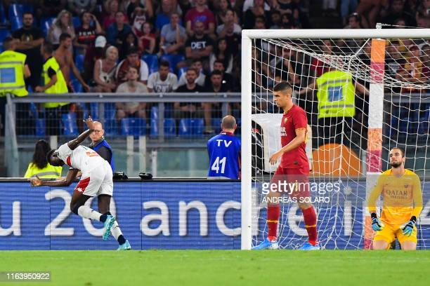 Genoa's Ivorian forward Christian Kouame celebrates after scoring past AS Roma's Spanish goalkeeper Pau Lopez during the Italian Serie A football...