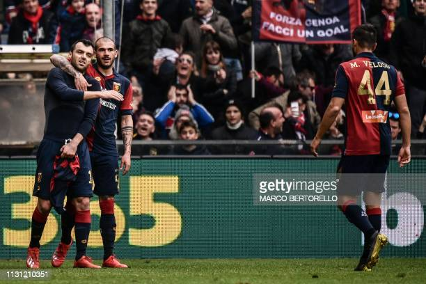 Genoa's Macedonian forward Goran Pandev celebrates with Genoa's Italian midfielder Stefano Sturaro after scoring during the Italian Serie A football...
