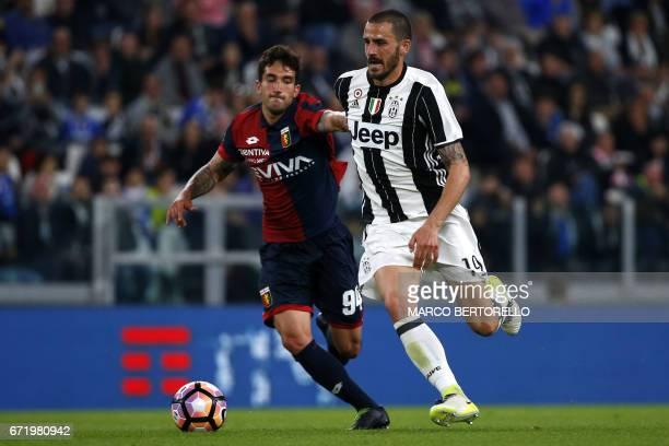 Genoa's midfielder Danilo Cataldi fights for the ball with Juventus' defender Leonardo Bonucci during the Italian Serie A football match Juventus Vs...