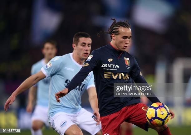 Genoa's midfielder fro Uruguay Diego Laxalt vies with Lazio's midfielder from Montenegro Adam Marusic during the Italian Serie A football match...