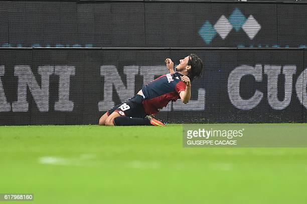 Genoa's midfielder from Serbia Nicola Ninkovic celebrates after scoring during the Italian Serie A football match Genoa vs AC Milan at 'Luigi...