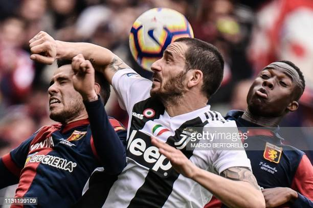 Genoa's Paraguayan forward Antonio Salabria, Juventus' Italian defender Leonardo Bonucci and Genoa's Italian forward Cristian Kouame go for a header...