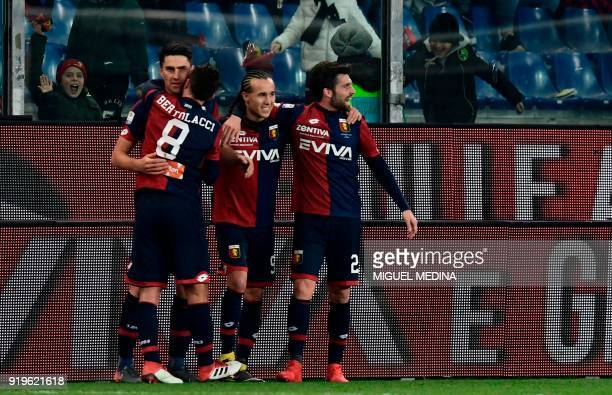Genoa's players celebrate with teammate Andrea Ranocchia after he scored during the Italian Serie A football match Genoa vs Inter Milan at the...