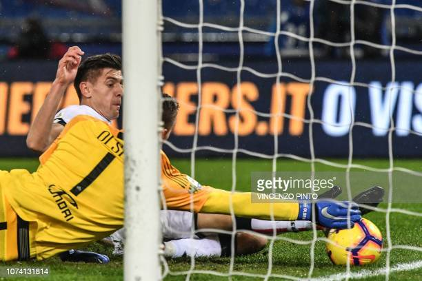 Genoa's Polish forward Krzysztof Piatek kicks the ball to pen the scoring despite AS Roma Swedish goalkeeper Robin Olsen during the Italian Serie A...