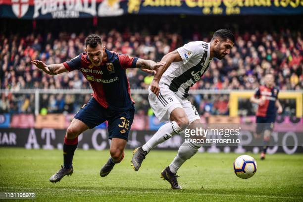 Genoa's Portuguese defender Pedro Pereira and Juventus' German midfielder Emre Can go for the ball during the Italian Serie A football Match Genoa vs...