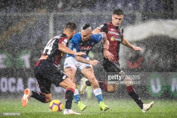 Genoa's Portuguese midfielder Miguel Veloso Napoli's Slovak midfielder Marek Hamsik and Genoa's Polish forward Krzysztof Piatek go for the ball...