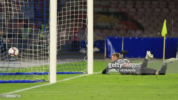 Genoa's Romanian goalkeeper Ionut Andrei Radu fails to stop the opening goal during the Italian Serie A football match Napoli vs Genoa on April 7...