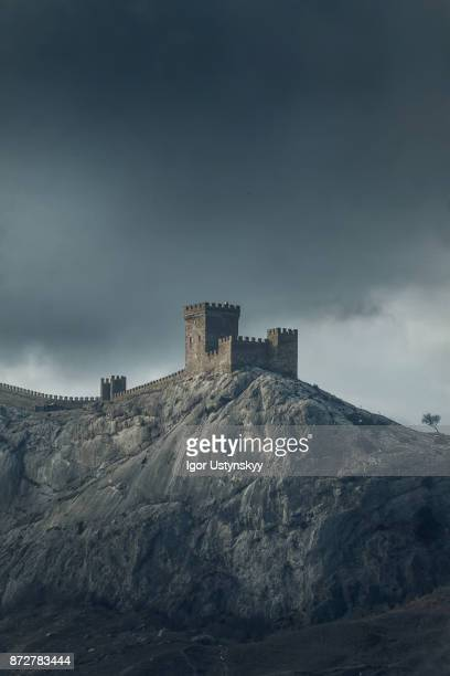 genoese fortress on a mountain top - castle stock photos and pictures