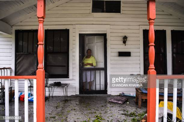 Genortra Robinson at the damage to her home after the Hurricane Sally made landfall in Pensacola Florida on September 16 2020 Hurricane Sally...