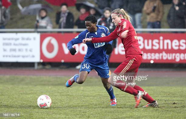 Genoveva Anonma of Potsdam challenges Amber Brooks of Munich during the Women's Soccer Bundesliga Match between Bayern Muenchen and 1 FFC Turbine...