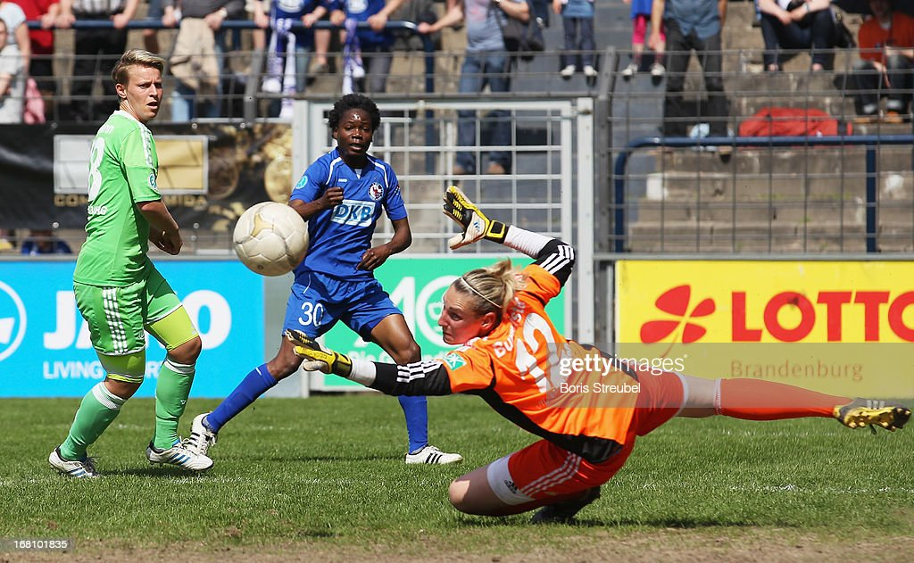 Genoveva Anonma of Potsdam (C) tries to score past goalkeeper Jana Burmeister of Wolfsburg during the Women's Bundesliga match between 1. FFC Turbine Potsdam and VfL Wolfsburg on May 5, 2013 in Potsdam, Germany.