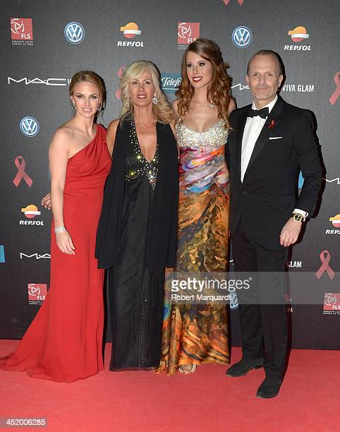 Genoveva Casanova guest Andrea Huisgen and Miguel Bose pose during a photocall for the '4th Annual Gala Sida Barcelona 2013' held at the El Museo...