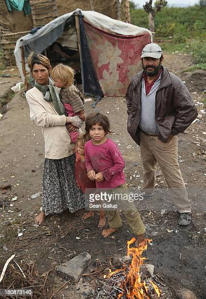 Genoveva who is pregnant and Vasili Lingurar stand with three of their children Alexandru Armando and Alexandra outside the makeshift and temporary...