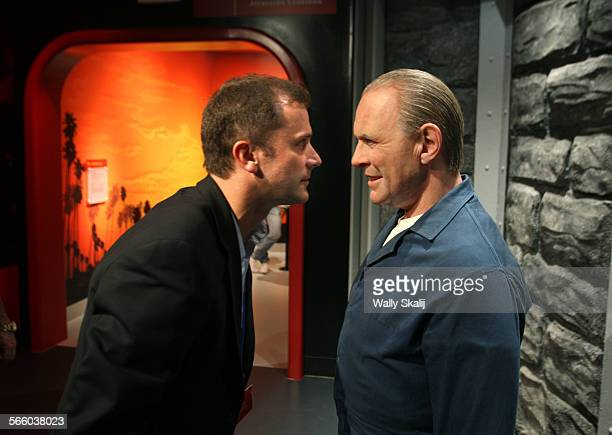 Genral Manager Adrian Jones stares intio the eyes of wax figure Anthony Hopkins and his role in Silence of the Lambs display at the new Madame...