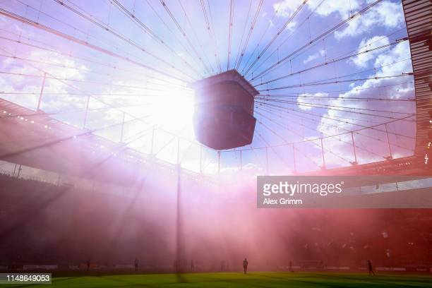 Genral view of the action as purple smoke from flares fill the air during the Bundesliga match between Eintracht Frankfurt and 1 FSV Mainz 05 at...