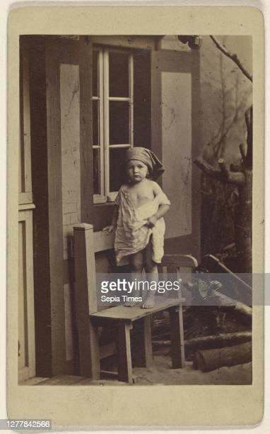 Genrebilder nach der Natur. Landliche Unschuld. Little girl with scarf on head, standing in a chair; German; about 1862; Albumen silver print.