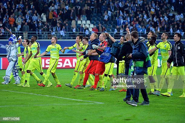 Gent players celebrate their victory over Valencia after the UEFA Champions League Group H match at Ghelamco Arena on November 4 2015 in Ghent Belgium