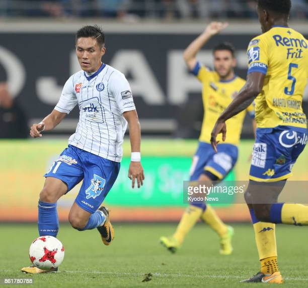 KAA Gent striker Yuya Kubo dribbles the ball near WaaslandBeveren defender Jonathan Buatu Mananga during the first half of a Belgian firstdivision...