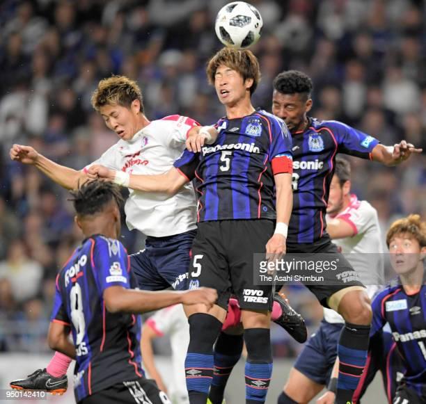 Genta Miura of Gamba Osaka and Yoichiro Kakitani of Cerezo Osaka compete for the ball during the JLeague J1 match between Gamba Osaka and Cerezo...