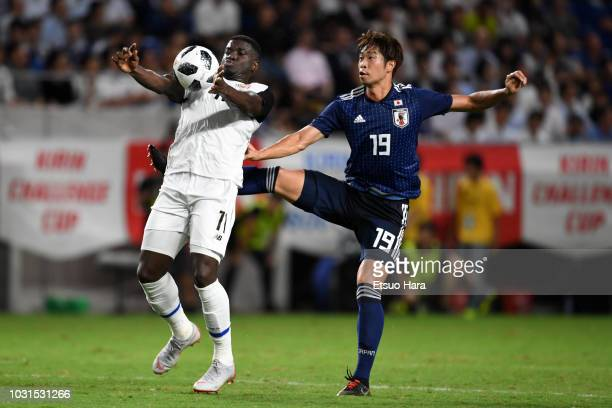 Genta Miura of Japan and Mayron George of Costa Rica compete for the ball during the international friendly match between Japan and Costa Rica at...