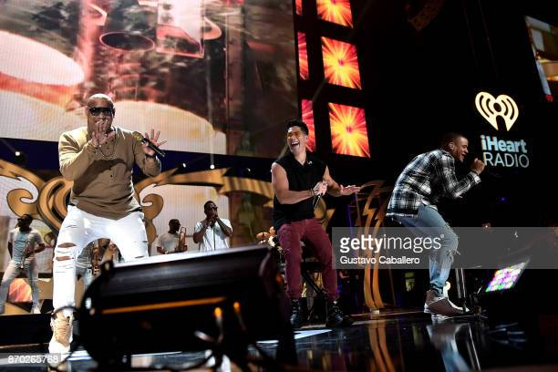 Gente de Zona and Chyno Miranda perform onstage during the iHeartRadio Fiesta Latina Celebrating Our Heroes at American Airlines Arena on November 4...