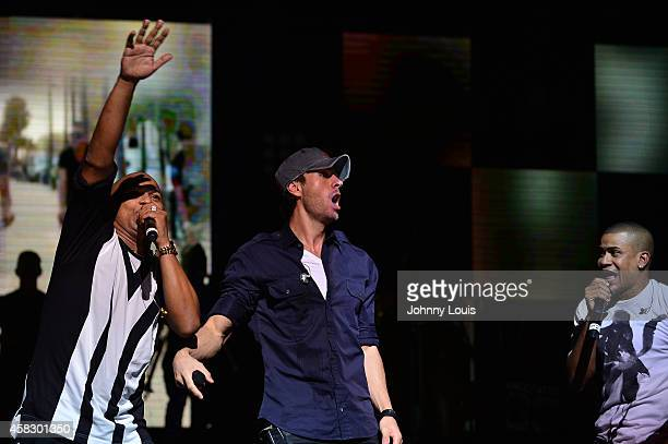 Gente De Zona and Enrique Iglesias perform at James L Knight Center on November 1 2014 in Miami Florida