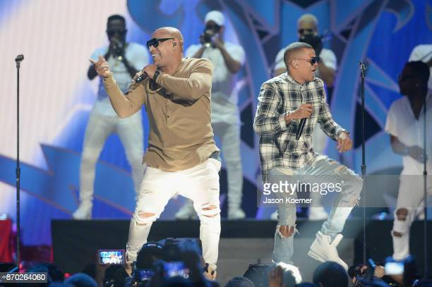 Gente de Zona performs onstage during the iHeartRadio Fiesta Latina Celebrating Our Heroes at American Airlines Arena on November 4 2017 in Miami...