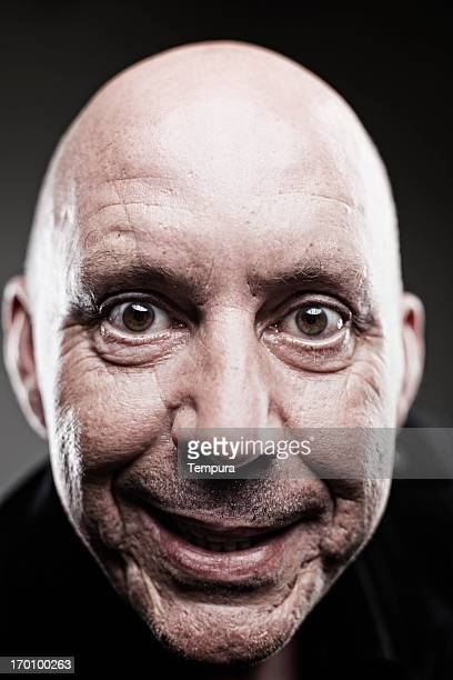 gentle man's face portrait close up. - big eyes stock photos and pictures