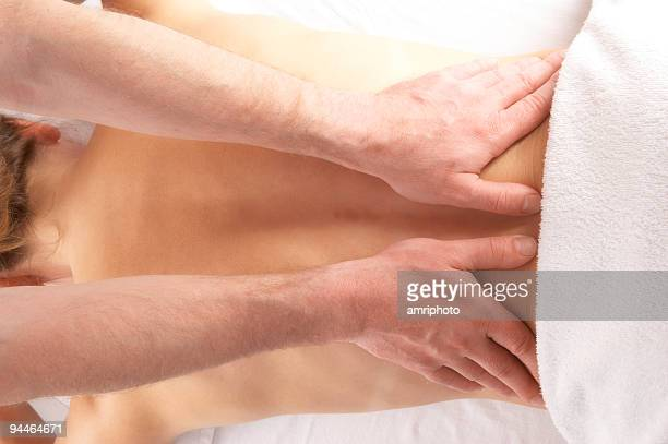 gentle massage of the lower back - lower back stock pictures, royalty-free photos & images
