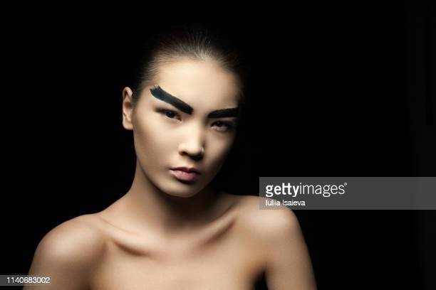 gentle model with painted eyebrows - vogue stock pictures, royalty-free photos & images