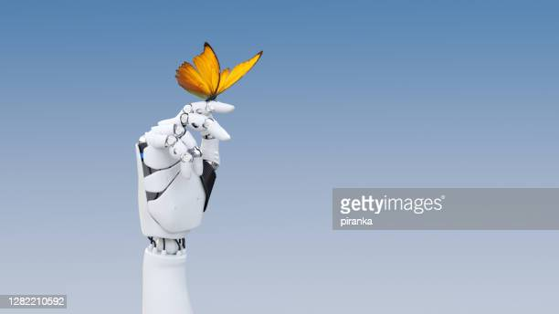 gentle robot hand - robot stock pictures, royalty-free photos & images