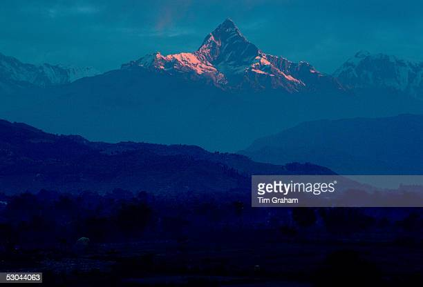 Gentle sunlight on Machhapuchhare Mountain in the Himalayas Pokhara Nepal