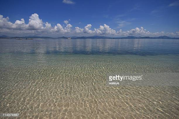 gentle water in yalongwan beach - sanya stock pictures, royalty-free photos & images