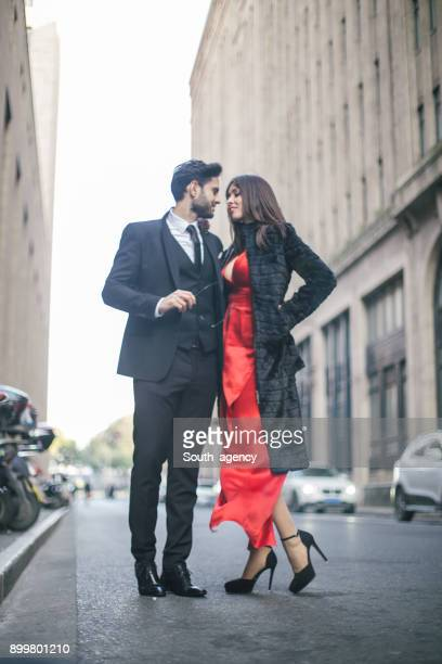 gentleman and beautiful lady - red dress stock photos and pictures