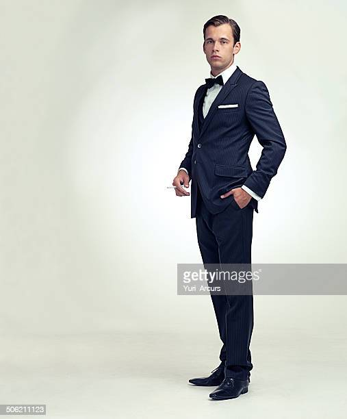 gentleman and his cigarette - evening wear stock pictures, royalty-free photos & images